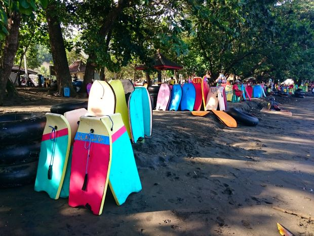 Colourful boards at Batu Karas shore
